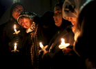Student Photographer of the Year: Runner UpAl Drago, Elon UniversityNida Allam, a senior at North Carolina State University, rests her head on Asheen Allam, during a candlelight vigil for murder victims Deah Barakat, 23, his wife Yusor Abu-Salha, 21, and Abu-Salha's sister, Razan Abu-Salha, 19, on Wednesday, Feb. 11, 2015, in Chapel Hill, N.C.