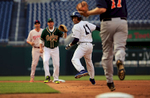 Student Photographer of the Year: Runner UpAl Drago, Elon UniversityRep. Cedric Richmond, D-La., looks back as he runs back and forth in between first baseman Rep. Tom Rooney, R-Fla., and second baseman Rep. Mark Walker, R-N.C., during the 54th Annual Roll Call Congressional Baseball Game at Nationals Park in Washington on Thursday, June 11, 2015. Richmond eventually slid safely back into first base.