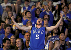 Student Photographer of the Year: Runner UpAl Drago, Elon UniversityJack Grady, a Duke sophomore, throws up his arms and celebrates as Duke takes the lead while watching the Final Four of the NCAA basketball championship in Cameron Indoor Stadium at Duke University in Durham, N.C. on Saturday, April 4, 2015. Grady wore his wrestling head gear from high school, which coincidently is also Duke blue.