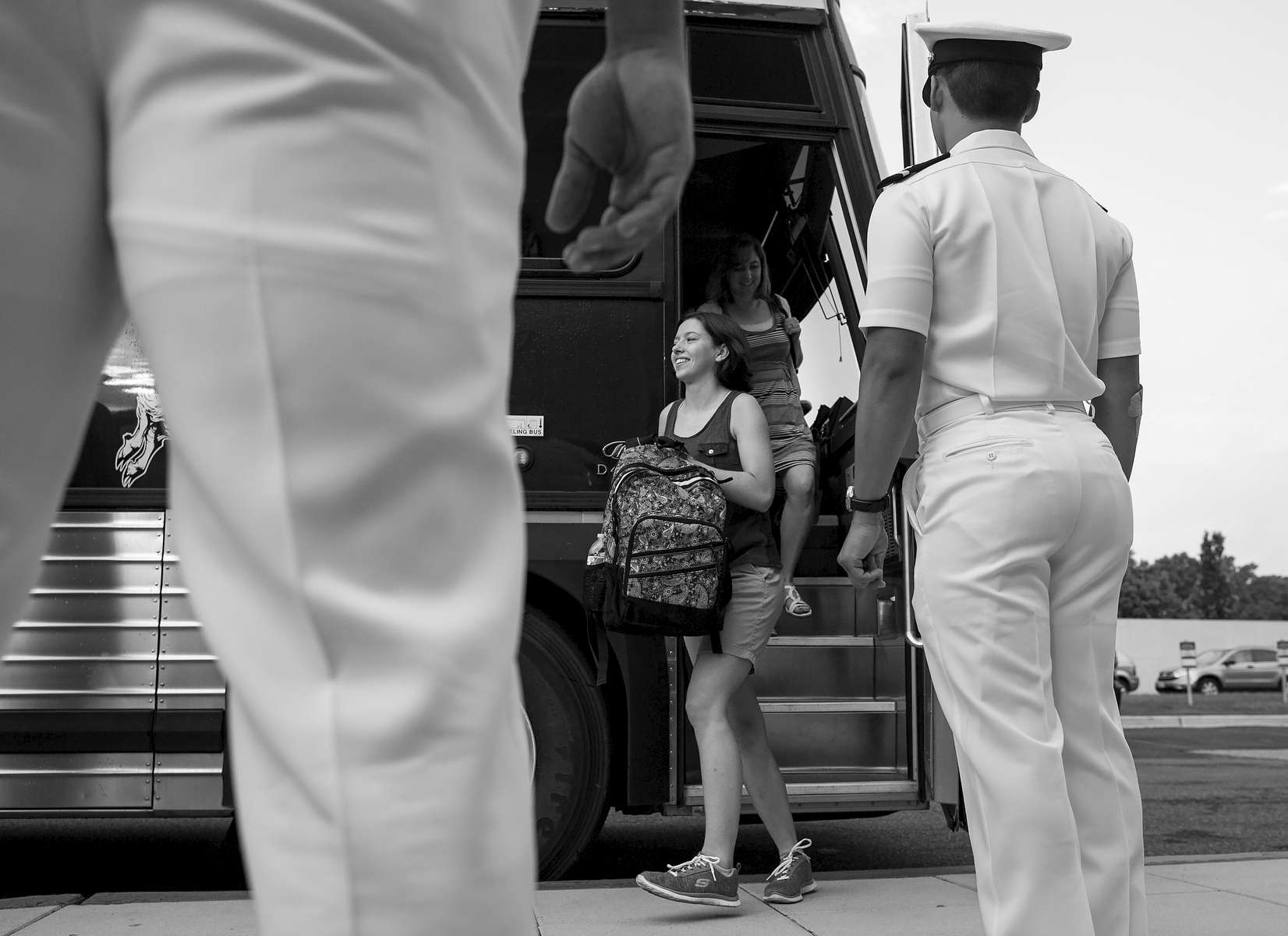 Student Photographer of the Year: Runner UpAl Drago, Elon University A plebe heads off the bus to begin Induction Day at the U.S. Naval Academy, Wednesday, July 1, 2015, in Annapolis, Md. More than 1,100 young men and women reported for {quote}I-Day,{quote} where they will receive haircuts, medical examinations, new uniforms and instructions on how to salute before taking an oath of office to become members of academy's newest class.