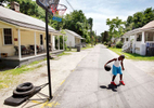 Sports Photographer of the YearMark Dolejs, The Daily DispatchZa'Vion Alston practices his basketball skills along Lamb Street on Tuesday afternoon. He and a couple of neighborhood friends try to play just about every day.