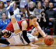 Sports Photographer of the YearMark Dolejs, The Daily DispatchLouisville's Sara Hammond dives over Duke's Rebecca Greenwell for the ball in their game at Cameron Indoor Stadium.