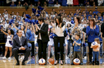 Sports Photographer of the YearMark Dolejs, The Daily DispatchDuke head coach Mike Krzyzewski receives a standing ovation from his wife Mickie and their three daughters and grandchildren during a ceremony honoring him for his 1000th career victory after their game against Georgia Tech.