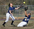 Sports Photographer of the YearMark Dolejs, The Daily DispatchNorthern Vance's Andrea Taylor (left) and Jamese Kelly attempt to catch a fly ball from a Southern Vance batter in their game at Aycock Recreation Center.