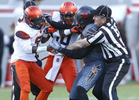Sports POY: Runner UpEthan Hyman, The News & ObserverAn official separates Syracuse's Brisly Estime (9) and N.C. State's Juston Burris (11) during the second half of N.C. State's 42-29 victory over Syracuse at Carter-Finley Stadium in Raleigh, N.C., Saturday, Nov. 21, 2015.  Syracuse's Dontae Strickland (18) is in the center. Estime was ejected from the game.