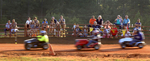 Sports POY: Runner UpEthan Hyman, The News & ObserverFans watch lawnmower races at the Ellerbe Lions Club Lawn Mower Racing in Ellerbe, N.C. Saturday, June 6, 2015. The events typically draw a crowd of about 200 people, said organizer Wayne Taylor.