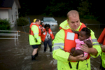 Third Place | Spot News Andrew Craft, The Fayetteville Observer Firefighter A.J. Brown carries Mechelle Borgelin as her mother, Candice Council, is helped by other firefighters out of her flooded home on the 700 block of Robeson Street on Thursday, Sept. 29, 2016, in Fayetteville, N.C.