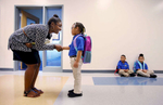 Honorable Mention | General News Mark Dolejs, Freelance New principal Ashley Johnson introduces herself to Jo' Hannah Cheatham on the first day of class for kindergartners and the first year for kindergartners at Henderson Collegiate.