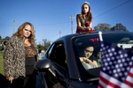 First Place | Feature Madeline Gray, North State Journal Miss Warsaw Middle School Zequoia Sanderson sits on top of a car for the 96th annual Warsaw Veterans Day parade as her mom Cathy Barden, left, and Zena Bell, in the car, prepare to ride in the parade as well.