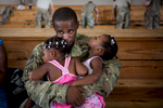Second Place | Feature Andrew Craft, The Fayetteville Observer Staff Sgt. Eukiston Hobdy holds his twin girls, Zaniyah and Zamiyah, on Friday, Aug. 12, 2016, at green ramp on Fort Bragg, N.C. Soldiers from 18th Airborne Corps are headed to Kuwait for a year-long deployment.