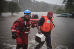 First Place | News Photo Story Andrew Craft, The Fayetteville ObserverA water rescue team leads Derrick Williams out of the water at the onramp of MLK Freeway after rescuing Williams from the flood waters on Robeson Street on Saturday, Oct. 8, 2016, in Fayetteville, N.C.