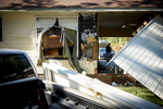 First Place | News Photo Story Andrew Craft, The Fayetteville ObserverA love seat sticks through a window and the back of the garage lays in ruins at Evelyn McCormick's home on Pennystone Drive on Tuesday, Oct. 11, 2016, in Gray's Creek, N.C.