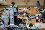 First Place | News Photo Story Andrew Craft, The Fayetteville ObserverJohnny Thompson looks through free piles of clothes at the Robeson County Water Dept. on Thursday, Oct. 13, 2016, in Lumberton, N.C.