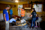 First Place | News Photo Story Andrew Craft, The Fayetteville ObserverFayetteville Christian students and staff help clean out Cynthia Quick's flood damaged home on Sessoms Street on Friday, Oct. 14, 2016, in Habitat for Humanity neighborhood in Fayetteville, N.C.