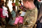 Second Place | News Photo Story Andrew Craft, The Fayetteville ObserverDevin, a Special Forces medic, checks on a baby that recently received a minor medical procedure to make sure everything is healing up properly on Monday, March 28, 2016, in the village of Pambayamba, Central African Republic.