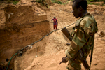Second Place | News Photo Story Andrew Craft, The Fayetteville ObserverCaptain Adam Aloro, a UPDF commander, talks with diamond miners about LRA activity in the area on Tuesday, March 29, 2016, in the Central African Republic.