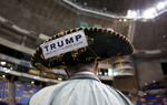 Third Place | News Photo Story Christine Nguyen, North State Journal Jim Yates of Laurens, S.C. wears a sombrero during the campaign rally for Donald Trump at Crown Coliseum in Fayetteville – the candidate's second stop in the state in the same week. Yates supports Trump because {quote}he tells it like it is{quote} and because Trump plans to build the wall between Mexico and the U.S.
