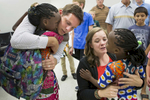 First Place | Feature Photo Story Madeline Gray, North State Journal Chad and Katie Coleman, center, hug their adopted daughters Safi, 6, left, and Sifa, 5, right, for the first time at the Charlotte airport. The Coleman family has been waiting over three years for the girls to be allowed to leave the Democratic Republic of the Congo to join their new family in North Carolina.