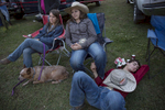 Second Place | Feature Photo StoryChristine Nguyen, North State Journal From right Josh Parker and Julie Layell relax with Julie's sister, Kaylee, after competing during the Jeff Hinson Memorial Rodeo.