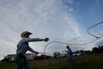 Second Place | Feature Photo StoryChristine Nguyen, North State Journal From left, Jacob Heath and Dylan Ray, both of Yadkin County, practice before the team roping competition.