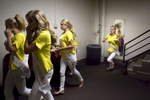 Third Place | Feature Photo StoryMadeline Gray, North State Journal Miss North Carolina Outstanding Teen contestants run off stage to go change for preliminary competitions at the Duke Energy Center for the Performing Arts.
