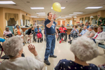 Honorable Mention | Feature Photo Story Allison Lee Isley, Winston-Salem Journal / Randolph Community College Denny lightens up the mood by bouncing a yellow balloon around the circle to fellow patients before the group completes their daily devotions Friday, July 17, 2016 at Trinity Living Center in Salisbury, N.C.