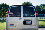 Honorable Mention | Feature Photo Story Allison Lee Isley, Winston-Salem Journal / Randolph Community College The Eaborns' passenger van is parked in the parking lot of Salisbury's City Pool during Denny and Eugenie's grandson, Chase Oliver's, 5, first swimming lesson Tuesday, June 14, 2016 in Salisbury, N.C.  The van is decorated with multiple stickers, magnets, and a license plate that spells out {quote}ADOPT10!{quote} symbolizing their ten adopted children.