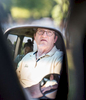 Honorable Mention | Feature Photo Story Allison Lee Isley, Winston-Salem Journal / Randolph Community College Denny gazes out of the passenger's side window of the family's passenger van as he sits in the air conditioned vehicle to stay out of the heat with his daughter, Zoe, 13, during his grandson, Chase Oliver's, 5, first swimming lesson Tuesday afternoon, June 14, 2016 at Salisbury's City Pool in Salisbury, N.C.