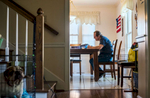 Honorable Mention | Feature Photo Story Allison Lee Isley, Winston-Salem Journal / Randolph Community College Denny sits at his kitchen table to pass time searching for words in his word search puzzle book Tuesday, June 28, 2016 at his home in Salisbury, N.C.