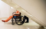 Honorable Mention | Feature Photo Story Allison Lee Isley, Winston-Salem Journal / Randolph Community College Lt. A. Mackey guides an inmate in a wheelchair through the pod to deliver him to the courtroom Friday, Apr. 29, 2016 at the Rowan County Detention Center in Salisbury, N.C.