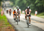 First Place | Sports Photo Story Ben McKeown, Freelance Aaron Snyder, of Xenia, Ohio, pedals his bike down N. Pea Ridge Road near Jordan Lake during the cycling portion of the Ironman 70.3 Raleigh triathlon in New Hope, N.C. on Sunday, June 5, 2016.