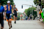 First Place | Sports Photo Story Ben McKeown, Freelance Particpants run through downtown in the Ironman 70.3 race in Raleigh, N.C. on Sunday June 5, 2016.