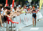 First Place | Sports Photo Story Ben McKeown, Freelance Lauren Barnett, of Leawood, KS, is overcome by emotion as she runs down the final stretch of the Ironman 70.3 Raleigh triathlon course in Raleigh, N.C. on Sunday, June 5, 2016. Barnett was the top overall woman finisher of the race.