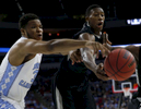 Third Place | Sports Photo Story Christine Nguyen, North State Journal North Carolina's Kennedy Meeks (3) and Providence's Kris Dunn (3) battle for a rebound during the second half of an NCAA Tournament college basketball game.