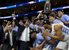 Third Place | Sports Photo Story Christine Nguyen, North State Journal Coach Roy Willams and the North Carolina Tar Heels celebrate after beating Notre Dame 88-74 to win the NCAA Tournament East Regional championship and advance to the Final Four.
