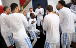 Third Place | Sports Photo Story Christine Nguyen, North State Journal North Carolina's Theo Pinson dances inside of the Tar Heels' huddle as part of a pre-game tradition before the NCAA Men's Basketball Championship semifinal game at the NRG Stadium in Houston, TX.