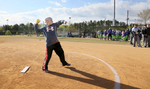 Honorable Sports | Feature Photo Story Mark Dolejs, Freelance Meghan Bunn throws out the first pitch during the Bunn Benefit Bash, a softball tournament held in her honor, at Oxford Athletic Park.
