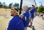 Honorable Sports | Feature Photo Story Mark Dolejs, Freelance As a Roxboro Community School batter hits a fly ball, Meghan Bunn watches with her dad, Brian (left), and Wade Bliss (right). Brian Bunn is the softball coach for Vance Charter School, where Meghan plays.