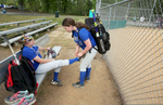 Honorable Sports | Feature Photo Story Mark Dolejs, Freelance Savannah Talley ties Meghan's shoes after their game at Granville Athletic Park against Kestrel Heights.