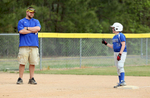 Honorable Sports | Feature Photo Story Mark Dolejs, Freelance Meghan Bunn talks to her coach/dad, Brian Bunn, after making it to third base safely in their game against Kestrel Heights.
