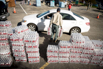 Photographer of the Year Andrew Craft, The Fayetteville Observer Volunteer Chip McNeill loads free water into cars as they pull up on Thursday, Oct. 13, 2016, in a shopping center parking lot on Fayetteville Road in Lumberton, N.C.
