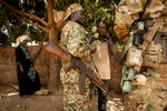 Photographer of the Year Andrew Craft, The Fayetteville Observer Ugandan People's Defense Force soldier translates for Devin, an American Special Forces medic, as they talk to villagers about medical ailments on Monday, March 28, 2016, in the village of Pambayamba, Central African Republic. The soldiers stop in the village to get intel on LRA activity in the area and provide the villagers with some basic medical assistance.