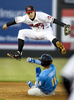 POY: Runner UpMadeline Gray, North State Journal Mudcats short stop Dansby Swanson (7) jumps over Myrtle Beach Pelicans short stop Gleyber Torres (11) as he slides into second base during the game on Friday, April 15, 2016 in Zebulon.