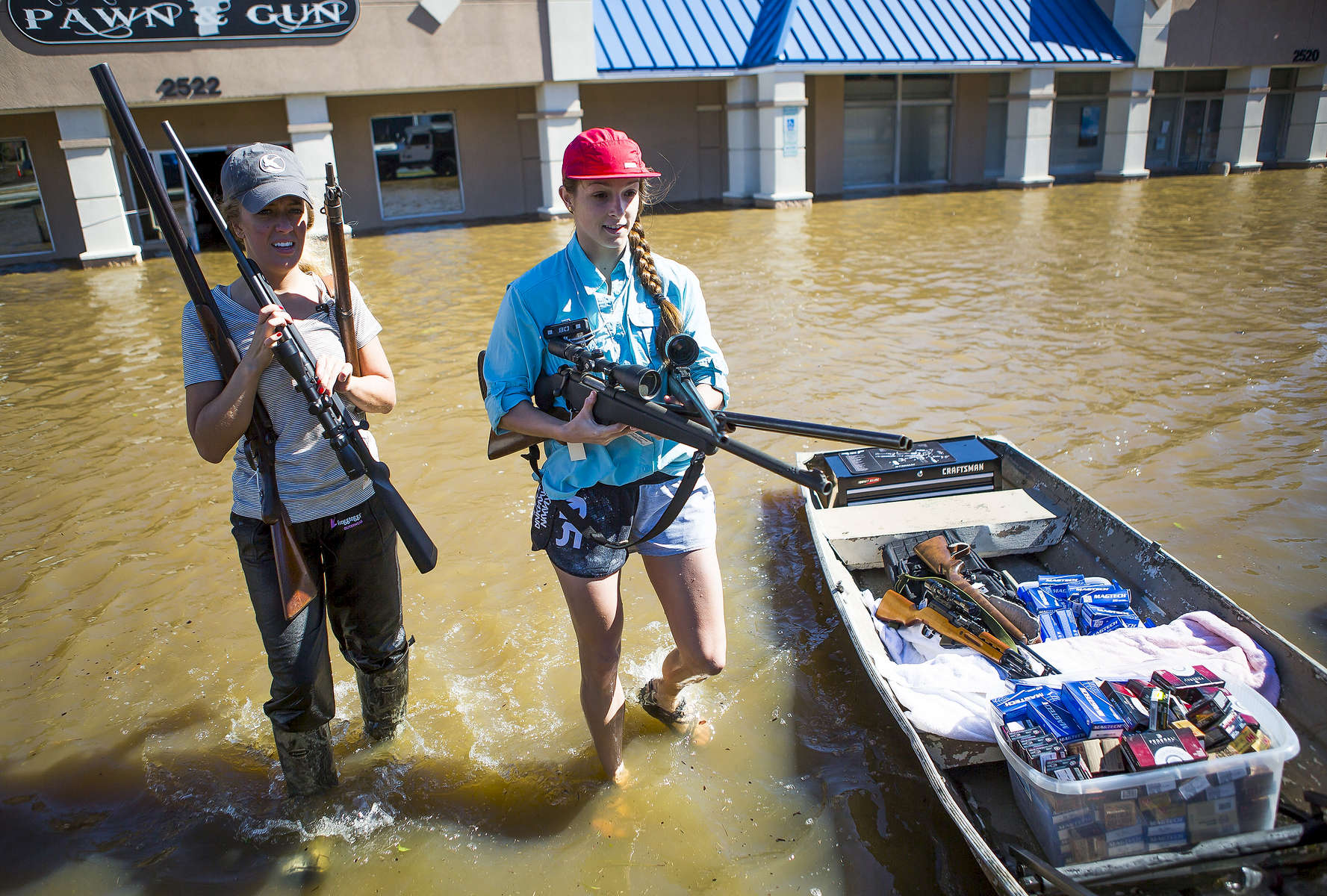 POY: Runner UpMadeline Gray, North State Journal Alex Flora, left, of Nashville, and Kathryn Hicks, right, of Rocky Mount, help to clear merchandise out of Carolina Jewelry, Pawn & Gun in Rocky Mount after it flooded as a result of heavy rains from Hurricane Matthew.