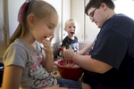 POY: Runner UpMadeline Gray, North State Journal Mason Griffin, right, makes peanut butter cookies with the help of his nieces Kailey Walters, 7, left, and Brilynn Walters, 5, center, who he watches most days after school. Mason came out as transgender over a year ago and has since been adjusting to life back home in a rural community after he left culinary school at the Art Institute of Charlotte due to health reasons.
