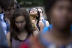 POY: Runner UpMadeline Gray, North State Journal Sydney Cheek, 19, a UNC Chapel Hill student, prays during a vigil for victims of police violence in Moore Square in Raleigh.