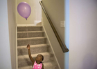POY: Runner UpMadeline Gray, North State Journal Sifa, 5, plays with a balloon in the basement of the house that she now shares with her adopted parents, Katie and Chad, her four new siblings and her biological sister Safi.