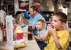 Student Photographer of the YearAllison Lee Isley, Winston-Salem Journal / Randolph Community College Donnie Rodgers, 5, from right, enjoys a meal with his brother, Joel, 2, and father, Nick, at the Hot Dog Shack Friday, Apr. 15, 2016 in Granite Quarry, N.C.