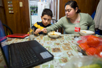 Student Photographer of the YearAllison Lee Isley, Winston-Salem Journal / Randolph Community College Judy Leal tries shows her son, Eduardo, 8, the proper way to cut his meatballs while his attention is devoted to the show playing on her laptop during dinner Tuesday evening, Feb. 16, 2016 at their home in Asheboro, N.C.