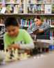 Student Photographer of the YearAllison Lee Isley, Winston-Salem Journal / Randolph Community College Judy takes a few moments to read a books while her son Eduardo, 8, learns to play chess Tuesday, Feb. 23, 2016 at Randolph County Public Library in Asheboro, N.C.